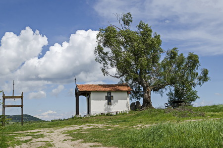 Beautiful  landscape with springtime venerable birch tree and old chapel, located in Plana mountain, Bulgaria Banco de Imagens