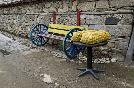 Fresh potatoes in sacks displayed on a street stall for sale, town Koprivshtitsa, Bulgaria, Europe Imagens