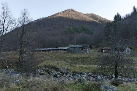 Old sheep cottage in mountain deciduous forest near river Vit, Teteven town, Balkan mountain, Bulgaria Imagens
