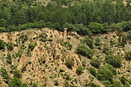 A view of the neighboring slope with new Stob pyramids of yellow rock formations, west share of Rila mountain, Kyustendil region, Bulgaria, Europe