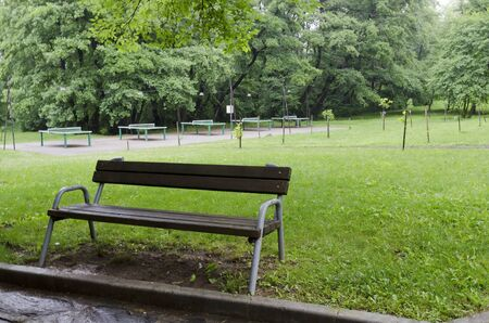 Table Tennis complex with lighting and many tables on a rainy day in rila park near town Dupnitsa, Bulgaria Foto de archivo - 129724979