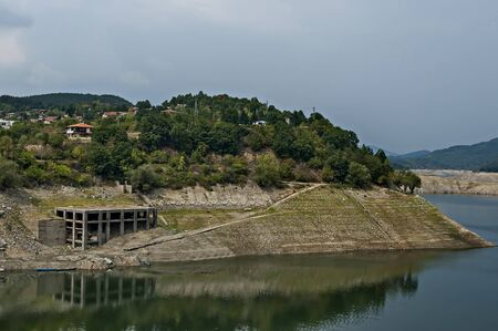 View from Topolnitsa dam, lake or barrage on the river Topolnitsa and part from village Muhovo, Ihtiman region, Bulgaria, Europe Фото со стока