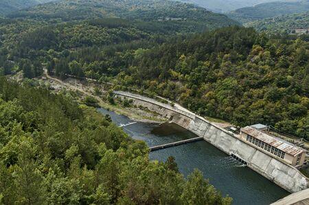 View of the old small hydro power plant and Topolnitsa dam  on the river Topolnitsa near village Muhovo, Ihtiman region, Bulgaria, Europe Фото со стока