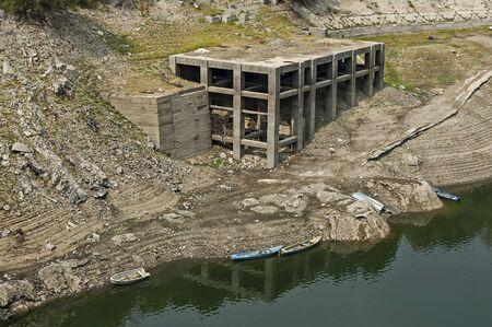 View from Topolnitsa dam, lake or barrage on the river Topolnitsa and old abandoned construction near village Muhovo, Ihtiman region, Bulgaria, Europe Фото со стока