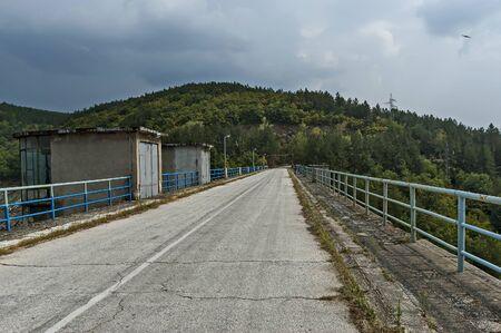 View from road over reservoir wall of Topolnitsa dam of river Topolnitsa near village Muhovo, Ihtiman region, Bulgaria, Europe