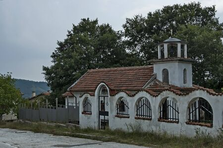 A beautiful landscape with a small old church in the village of Muhovo, Ihtiman region, Bulgaria, Europe Фото со стока