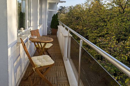 Balcony of a new apartment with table and chairs in town Kazanlak, Bulgaria