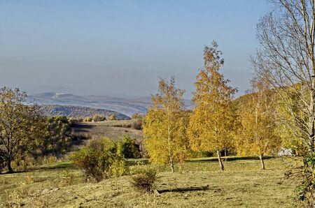 Amazing autumn view of glade, hill, forest with deciduous trees  near to pretty village Zhrebichko, Bratsigovo municipality,  Rhodope mountains, Bulgaria