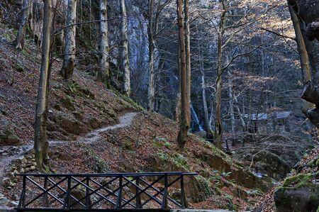 Autumn walk through the labyrinth of the Teteven Balkan with high peaks, river, bridge and waterfall, Stara Planina, Bulgaria Banco de Imagens