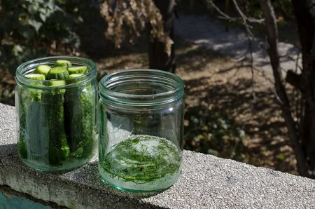 Two glass jars with the necessary preparation for  traditional home-made canning cucumbers, Sofia, Bulgaria