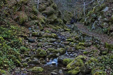 Autumn walk through the labyrinth of the Teteven Balkan with high peaks, river and bridge, Stara Planina, Bulgaria Banco de Imagens