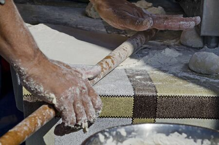 Technology for the manual preparation of dough for pizza with a rolling pin and flour, Sofia, Bulgaria