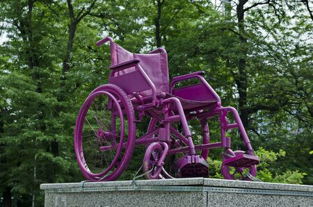 Old wheelchair on pedestal in front of the national stadium, Sofia, Bulgaria 写真素材