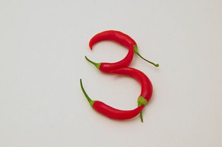 Sign 3, made from the fruit of fresh chilli red pepper with a green stalk, Sofia, Bulgaria