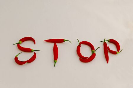 Sign or symbol Stop, made from the fruit of fresh chilli red pepper with a green stalk, Sofia, Bulgaria