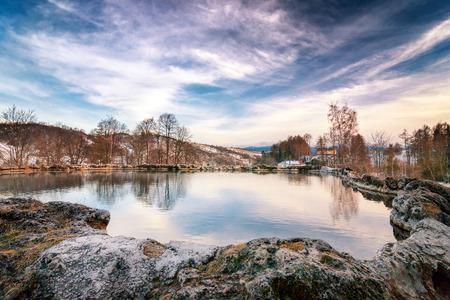 Travertine lake with hot water close to the spa Vysne Ruzbachy, Slovakia, Europe. Stock Photo
