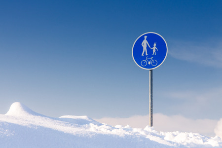 snowy traffic sign - walkway for pedestrians and cyclists in snowdrift
