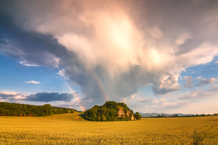 Landscape after a storm with dramatic sky and rainbow, Slovakia, Europe. Reklamní fotografie