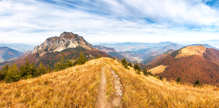 A hiking trail on a mountain ridge overlooking the hills of the Mala Fatra National Park in northern Slovakia, Europe. Stock Photo