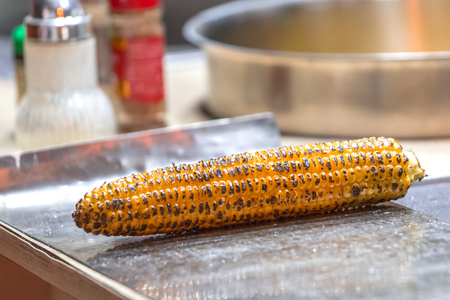 Freshly roasted corn ready for sale in a street stall.