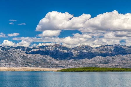 The landscape with sea bay below The Velebit Mountains with the national park Paklenica, Croatia, Europe.