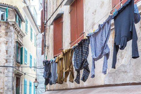 Men's washed laundry hanging on the facade of an old house in Rovinj town, Croatia, Europe.