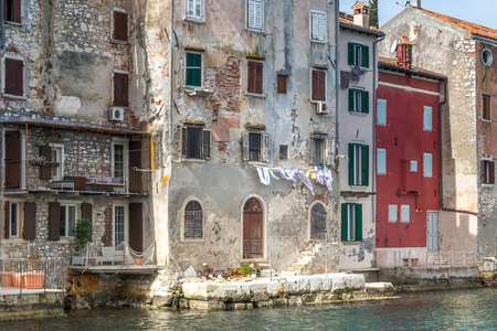 Historic buildings on the coast of Rovinj town on Adriatic sea, one of major tourist attractions at Istria in Croatia, Europe. Stock Photo