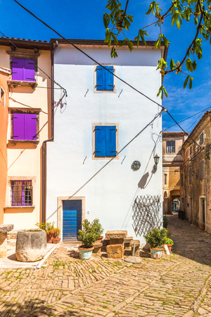 Ancient colorful houses on a stone street in Groznjan village, Istria, Croatia, Europe.