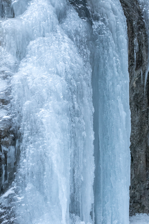Detail of a winter landscape, icefall on a rock wall. Reklamní fotografie