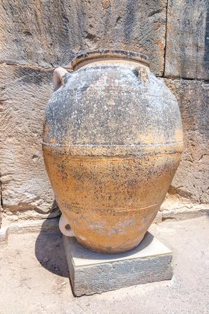 Pithoi, storage jars at The Minoan Palace of Phaistos on Crete, Greece, Europe.