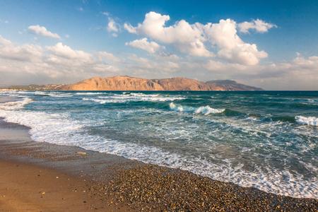 Sandy beach of resorts on northwest of Crete island between Chania and Rethymno cities, Greece, Europe.