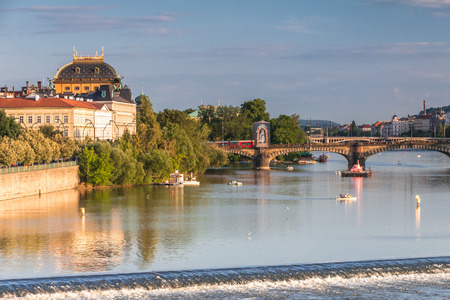 Vltava river and waterfront of the old town with the theater in Prague at sunset, Czech Republic, Europe. 版權商用圖片