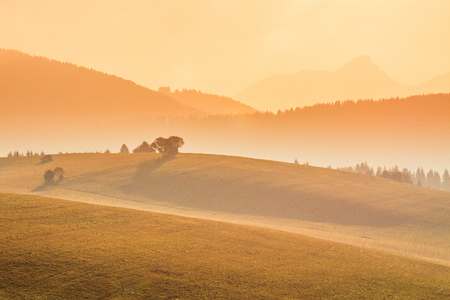 Autumn landscape, sunrise in a foggy morning, Slovakia, Europe.