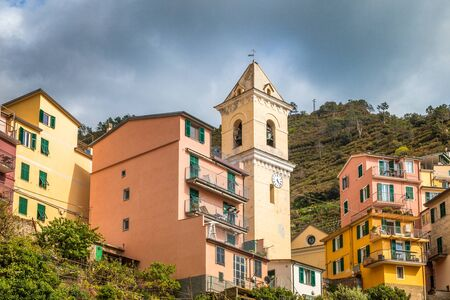 Historic building with bell tower in Manarola, the Cinque Terre towns, Italy.