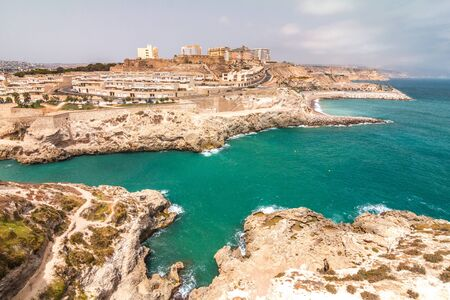 Melilla, a Spanish province bordering with Morocco in Africa. View of the city walls on the rocky coast of the Mediterranean Sea.