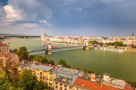 Budapest, panoramic view of The Hungarian Parliament Building, historic buildings and the Chain Bridge over Danube river.