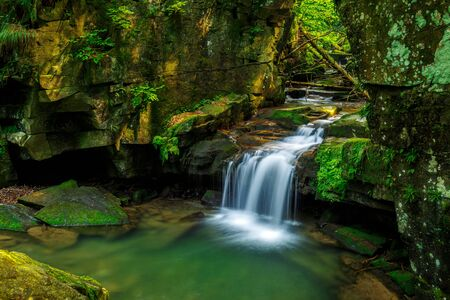 Waterfalls in green forest during a summer, exposure with a long time. The river Satina in the Beskydy Mountains, Czech Republic, Europe. Stockfoto