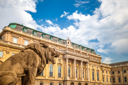 The Buda Castle with one of the lions in the inner courtyard, Budapest, Hungary, Europe.