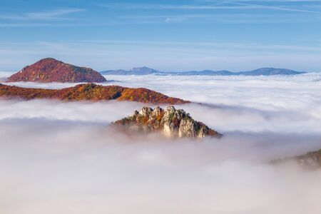 Mountain peaks over misty autumn landscape. Morning inversion in the Sulov rock mountains, Slovakia Europe.