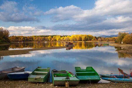 Boats on The Liptovska Mara dam in the morning light at autumn, the area of Liptov in Slovakia, Europe.