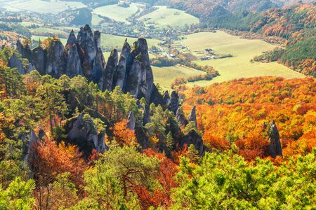 Brightly colored forests of mountain valley at autumn. National Nature Reserve Sulov Rocks, Slovakia, Europe.