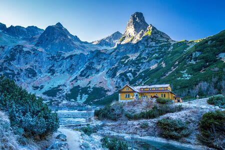 Frozen mountain valley at late autumn period. The Valley with a cottage at the Green Lake in The High Tatras National Park, Slovakia, Europe.