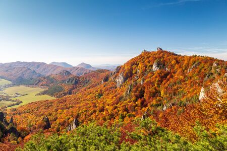 Brightly colored forests of mountains at autumn. National Nature Reserve Sulov Rocks, Slovakia, Europe.