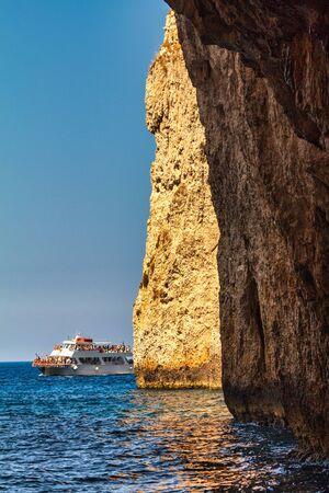 Cruise along the island of Paxos with sea caves, near the Corfu island, Greece, Europe.