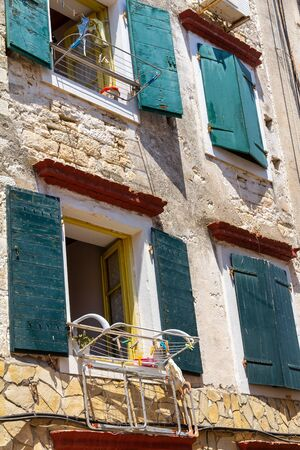 Facade of an old house in a narrow street in Gaios port town on the Paxos island, Greece, Europe.