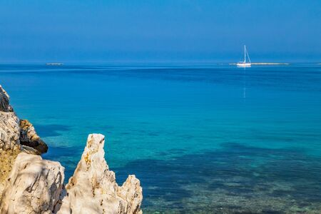 Sailing boat on the peaceful Adriatic Sea. Green lagoon sea bay in Porec, Croatia - Istria, Europe.