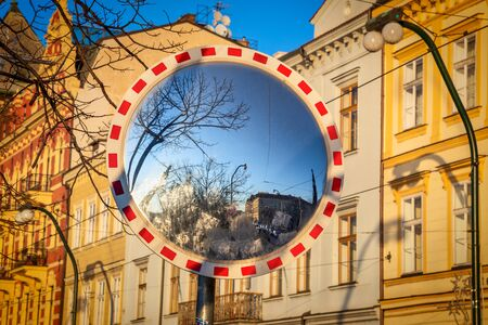Reflection of city street in road traffic mirror. Stockfoto