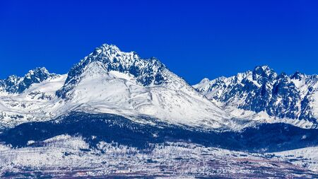 View of the landscape with snowy mountains. The High Tatras National Park, Slovakia, Europe.