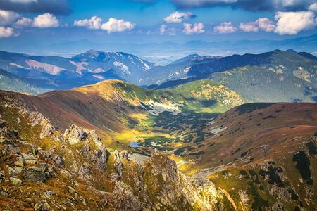 Mountainous landscape with hills and valleys at a sunny day in autumn season. The Low Tatras National Park in Slovakia, Europe.