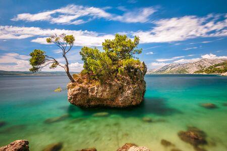 Brela Stone, a small rock island just off the Punta Rata beach in Brela. The Makarska Riviera, Croatia, Europe. Photo with long exposure time.